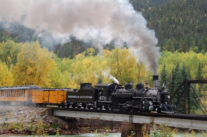 durango silverton steam train crossing a bridge in elk park